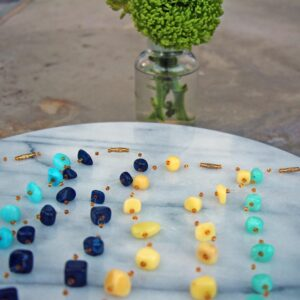 Read more about the article Floating Stone & Maasai Bead Necklace, Navy