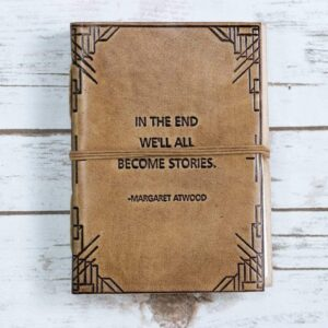 Read more about the article We All Become Stories Margaret Atwood Quote Leather Journal – 7×5 Tan Color – Blonde / Leather