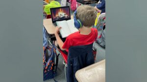 Read more about the article A photo of a third grader reading in front of a virtual fireplace is getting lot