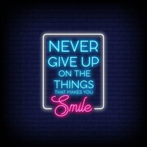 Read more about the article Never Give Up On The Things That Makes You Smile Neon Signs Style Text Vector